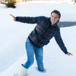 Young man in winter boots fell into a deep white snow — Stock Photo