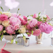 Beautiful bright bouquet of peony on the wedding table in vase — Stock Photo
