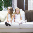 Little adorable girls waiting their Christmas gifts in New Year's Eve — Stock Photo