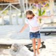 Stock Photo: Happy little girl on beach vacation