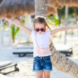 Adorable little girl on beach vacation — Stock Photo