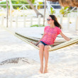 Young woman on tropical vacation relaxing in hammock — Stock Photo
