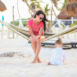 Mother and daughter on tropical vacation relaxing in hammock — Stock Photo