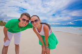 Happy young couple have fun on exotic beach looking at camera — Stock Photo