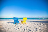 Beach wooden colorful chairs for vacations and summer getaways in Tulum, Mexico — Stock Photo