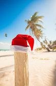санта клауса шляпу на отдыхе — Стоковое фото