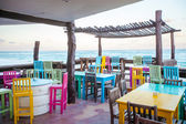 Bright colored bar-restaurant on the white sandy beach in Tulum — Foto de Stock
