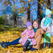Stock Photo: Little girls and young mother in autumn park