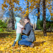 Happy father and little girl in autumn park — Stock Photo