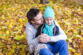 Young father have fun with his cute daughter in autumn park at sunny day — Stock Photo