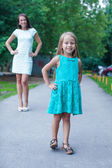 Close-up little fashion girl on background of young mother — Stock Photo