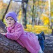 Little happy girl in autumn park — Stock Photo