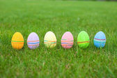 Colored colorful easter eggs in the grass — Stock Photo