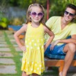 Close up little girl background her young dad at the swimming pool — Stock Photo #35211445