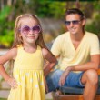 Close up little girl with her young dad at the swimming pool — Stock Photo
