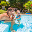 Little cute girl play with dad at the pool in tropical hotel — Stock Photo