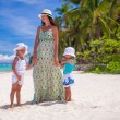 Stock Photo: Young mother with her adorable daughters on beach in Philippines