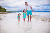 Little girls walking around with dad on a tropical beach — Stock Photo