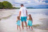 Family of three on tropical white beach — Stock Photo