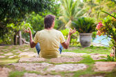 Young man sitting in the lotus position — Stock Photo