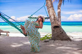Young woman enjoying vacation in the hammock — Stock Photo