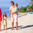 Beautiful family of four have fun on the beach in Philippines — Stock Photo