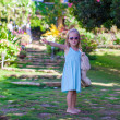 Little girl walking in tropical green hotel — Stock Photo