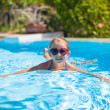 Little adorable happy girl swims in the swimming pool — Stock Photo