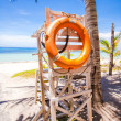 Stock Photo: Lifeguard tower with lifeline of palm trees on white sand beach