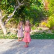 Two little girls on footpath in a tropical country — Stock Photo