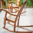 Wooden rocking chair on the terrace of an exotic hotel — Stock Photo #35226599