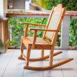 Wooden rocking chair on the terrace of an exotic hotel — Stock Photo #35226603