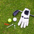 Stock Photo: Golf equipment on green grass