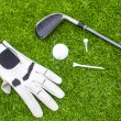 Golf equipment on green grass — Stock Photo
