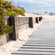 Stock Photo: Close-up view of wood board walk in beach