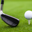 Stock Photo: Golf tee ball club driver in green grass course closeup