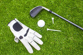 Golf equipment on green grass — Stock fotografie