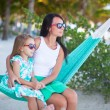 Young mommy and  little girl on tropical vacation relaxing in hammock — Stock Photo