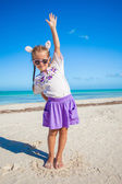 Adorable little girl in easter costume on the exotic beach — Stockfoto