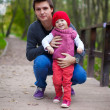 Portrait of happy father with daughter in the park at warm autumn day — Stock Photo