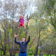 Young father with his cute little girl have fun outdoor in autumn — Stock Photo #37072011