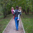 Back view of father and his two little daughters outdoor — Stock Photo #37072129