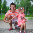 Young happy father with cute daughter in park have fun — Stock Photo #37072499