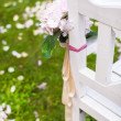 Wedding benches and flower for ceremony outdoors — Stock Photo #37073197