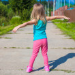 Little girl walking outdoor and having fun — Stock Photo