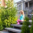 Little girl walking outdoor and having fun in the  garden — Stock Photo