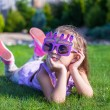 Stock Photo: Adorable little girl in Happy Birthday glasses smiling outdoor