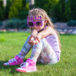 Stock Photo: Adorable little girl with Happy Birthday glasses smiling outdoor