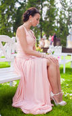 Beautiful young girl in a long dress at the ceremony outdoors — Stok fotoğraf