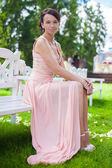 Beautiful young girl in a long dress at the ceremony outdoors — Stock Photo